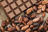 picture of cocoa beans  - Chocolate and cocoa beans on burlap sweet foods - JPG