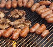 picture of grilled sausage  - Barbecued meat and pork sausages on grill - JPG