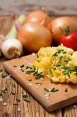 picture of scrambled eggs  - Vertical photo of morning breakfast with scrambled eggs mixed with chive - JPG