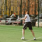 foto of early-man  - young man play tennis outdoor on tennis field at early morning - JPG