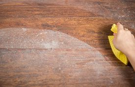 pic of disinfection  - Wiping dusty wood using yellow rag - JPG