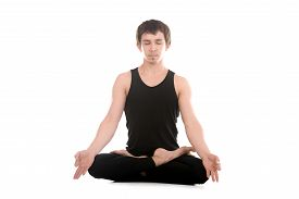 image of pranayama  - Sporty young man meditating with closed eyes in cross - JPG