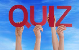 foto of quiz  - Many Caucasian People And Hands Holding Red Straight Letters Or Characters Building The English Word Quiz On Blue Sky - JPG