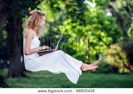 girl levitates with laptop