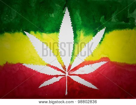 Negative space of cannabis leaf on rastafarian flag