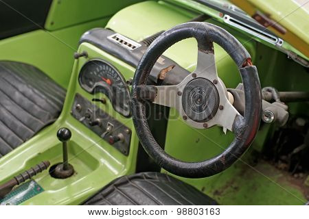 Interior Of Old Classic Car With Steering Wheel And Dashboard