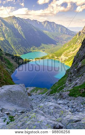 Two lakes in mountains.