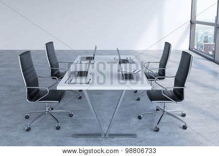 Modern Meeting Room With Huge Windows Looking At New York City. Black Leather Chairs And A White Tab