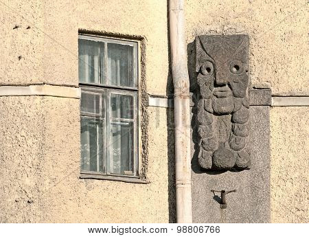 Vyborg. Russia. Fragment of a building in the National Romantic Style. Mask on the wall