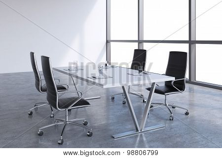 Modern Meeting Room With Huge Windows With Copy Space. Black Leather Chairs And A White Table With L