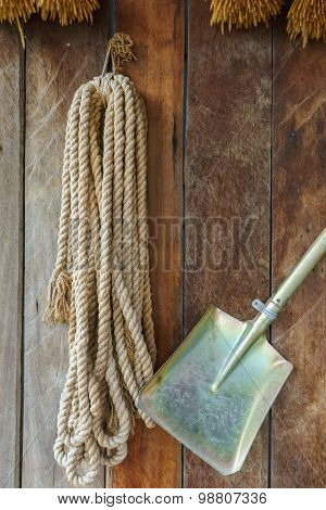 Rope And Shovel Hang On The Wooden Wall