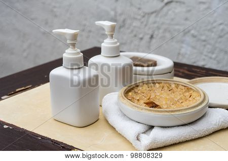 Lotion Bottles And Herb For Spa Treatment