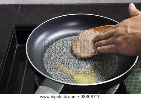 Chef Cooking Hamburger On The Pan