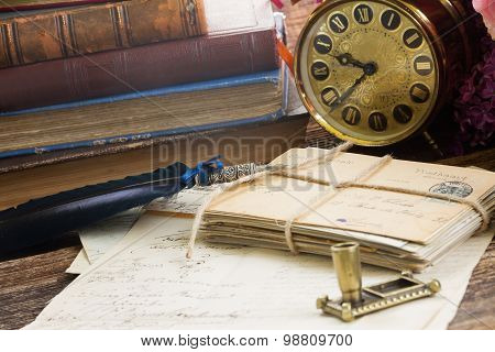 antique  clock with pile of mail
