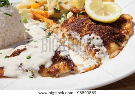 Close Up Of Fried Deep Sea Perch With Fragrant Rice And Cream Sauce