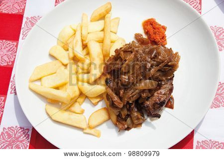 Close Up Of Beef Steak With Fried Onions And French Fries