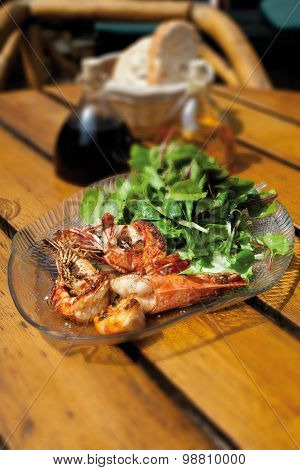 Close Up Of Roasted King Prawns With Mixed Salad