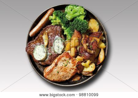 Close Up Of Gourmand Pan With Roasted Meat,herbed Butter,fried Potatoes And Broccoli Against Grey Ba
