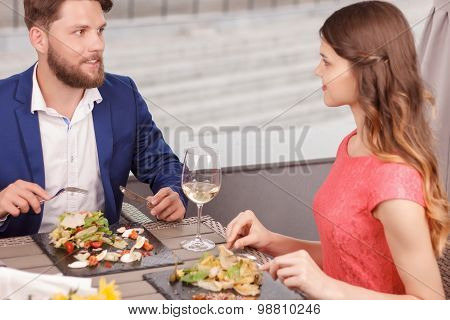Pleasant couple during date in restaurant