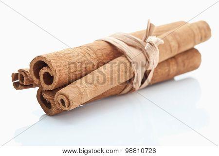 Bundled Cinnamon Sticks On White Background