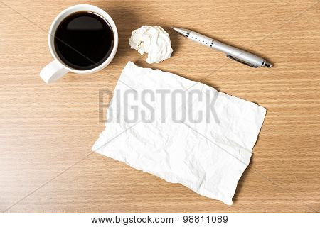 Paper And Crumpled With Pen And Coffee Cup