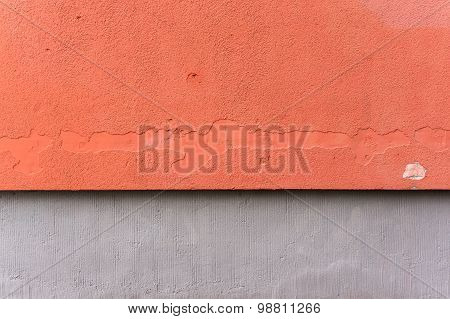 Outside Wall With Aged Orange Colored Ornate Plaster And Gray