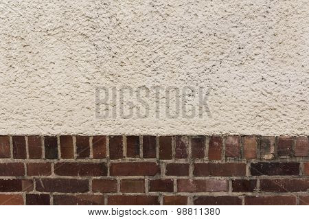 Exteriror wall with clinker bricks and plaster