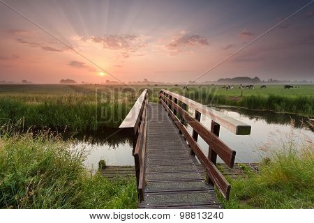 Beautiful Sunrise Over Bike Bridge In Farmland