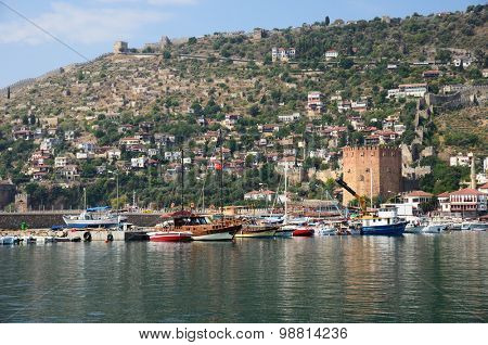 Alanya, Turkey, Jule 25, 2015. Wall of fortress and Red Tower (Kizilkule) in Alanya