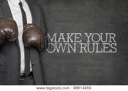 Make your own rules on blackboard with businessman on side