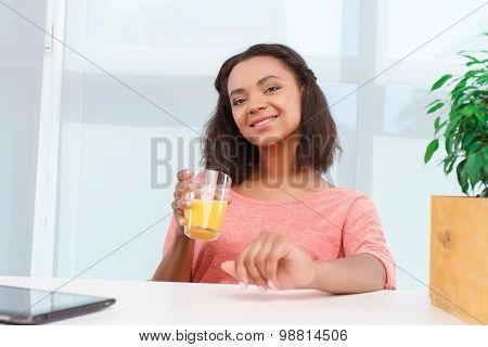 Pretty mulatto woman with juice