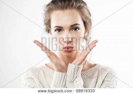 Pretty woman gives a kiss