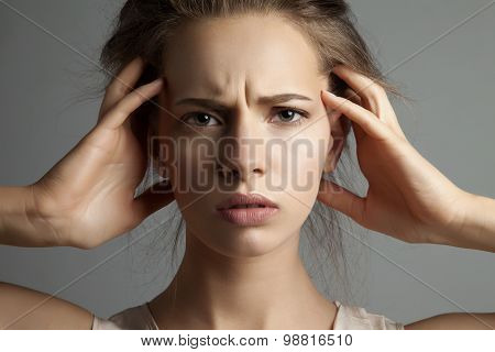 Woman in stress watching at camera