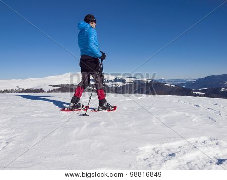 A Man In Snowshoes Is The Snow.