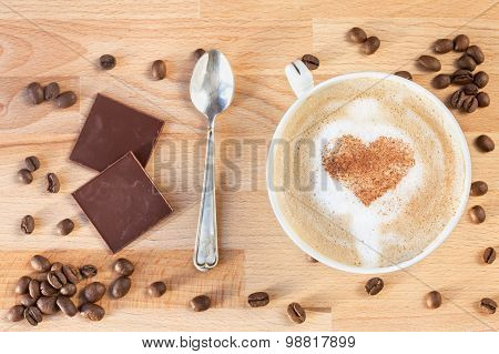 The cup of cappuccino with cinnamon hearts painted