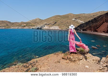 Woman  Looks At The Red Beach In Santorini, Greece
