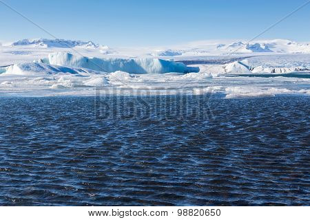 Blue icebergs floating in the Jokulsarlon lagoon