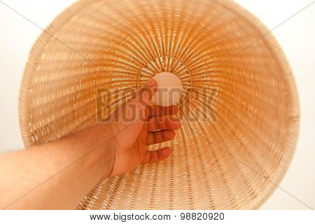 Hand Changing Lightbulb