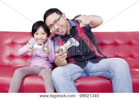 Cheerful Girl And Dad Playing Video Game