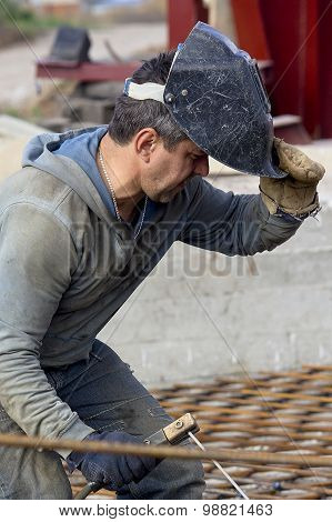 Krasnoarmejsk, Ukraine - October 18, 2012: Welder At Work. Construction Headgears