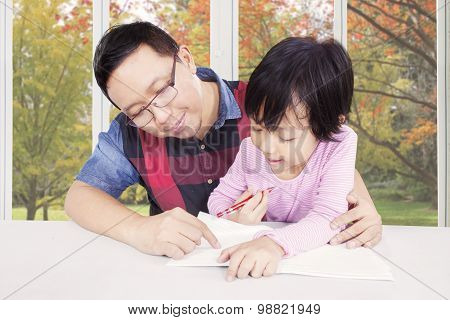 Father Helps His Daughter To Study