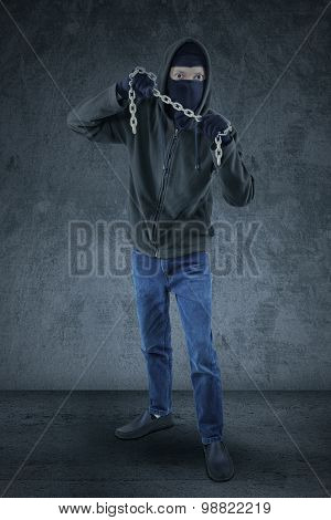 Frightening Murderer Carrying A Chain