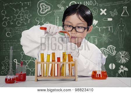 Kid Making Chemistry Research In The Lab