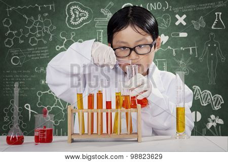 Little Boy Learning Chemistry In The Lab