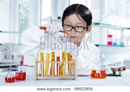 Little Scientist Making Experiment In The Lab