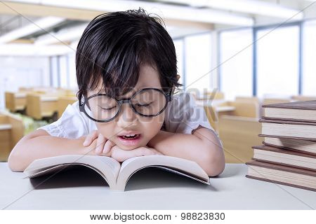 Little Student Enjoy Read Book In Class