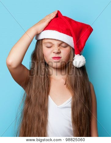 Young Sad Girl In Santas Hat