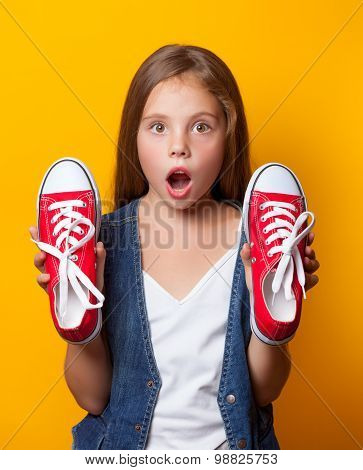 Young Surprised Girl With Red Gumshoes