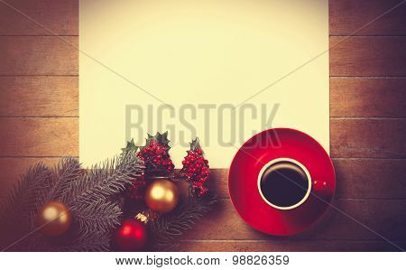 Coffee And White Paper Near Branch With Christmas Toys