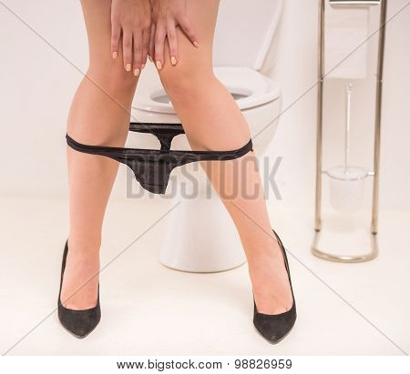 Woman In Toilet